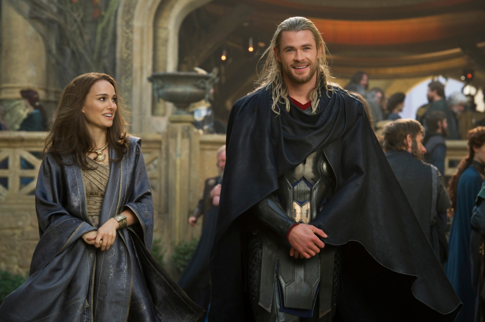 """FILE - This publicity photo released by Walt Disney Studios and Marvel shows Natalie Portman, left, as Jane Foster and Chris Hemsworth as Thor, in Marvel's """"Thor: The Dark World."""" Disney is previewing several of the studio's upcoming live-action films for fans at the D23 Expo, Aug. 9-11, 2013, a three-day Disney extravaganza at the Anaheim Convention Center. """"Thor: The Dark World,"""" """"Captain America: Winter Soldier,"""" """"Muppets Most Wanted,"""" """"Saving Mr. Banks"""" and """"Tomorrowland"""" are just some of the movies that will be teased at a Saturday morning presentation. (AP Photo/Walt Disney Studios/Copyright Marvel, Jay Maidment, File)"""