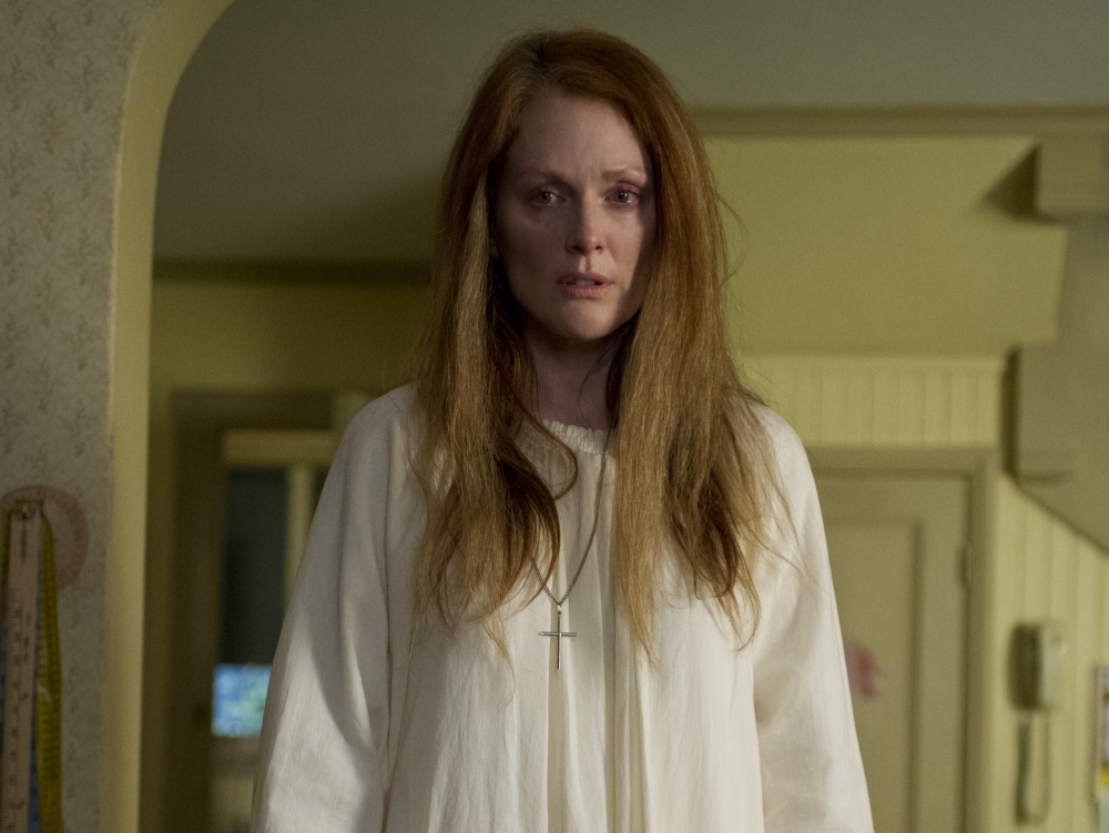 Julianne Moore takes on the problematic-parent in the remake — complete with long wild hair and a white nightgown reminiscent of Piper Laurie's in the original fil