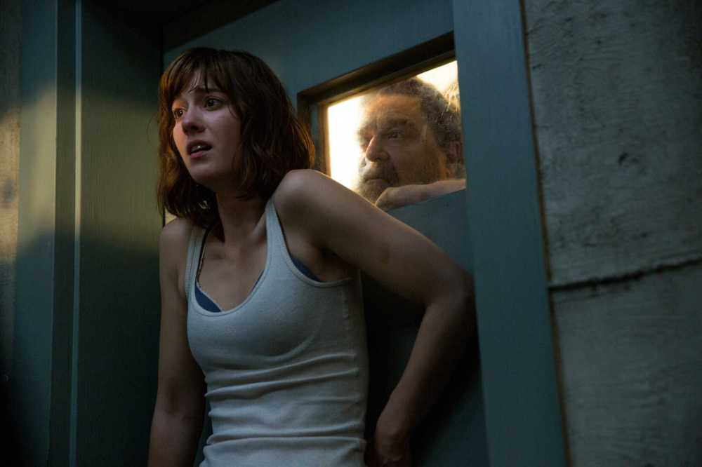 """This image released by Paramount Pictures shows Mary Elizabeth Winstead, left, and John Goodman in a scene from """"10 Cloverfield Lane."""" (Michele K. Short/Paramount Pictures via AP)"""